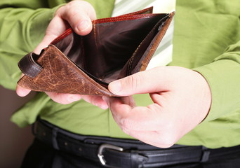 Empty wallet in male hands - poor economy