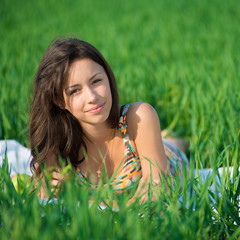 Happy girl on green grass