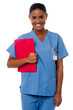 Active female nurse holding clipboard, at duty
