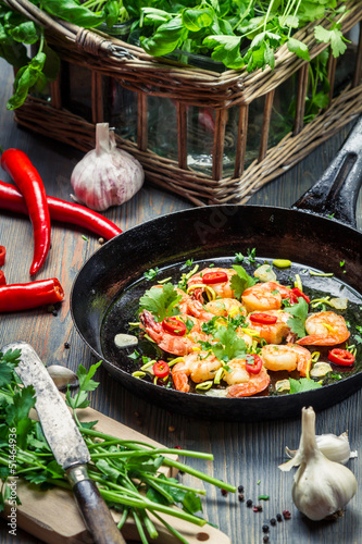 Shrimps served on a pan with fresh herbs
