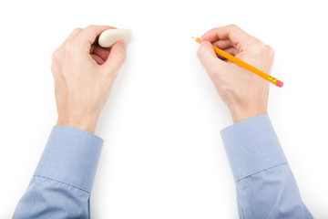 Man holding pencil and eraser