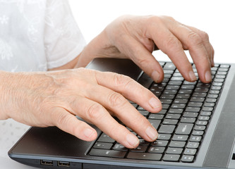 Old person hands typing on a keyboard. isolated