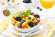 Cornflakes, fresh berries and orange juice for breakfast