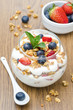 layered dessert with yogurt, granola and fresh berries