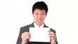 Asian businessman holding up a white paper