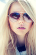 portrait of a beautiful girl in glasses close up