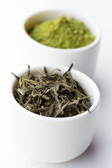 Dry green tea leaves and matcha tea