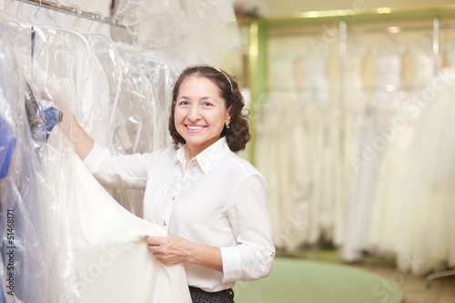 shop consultant  at shop of wedding fashion