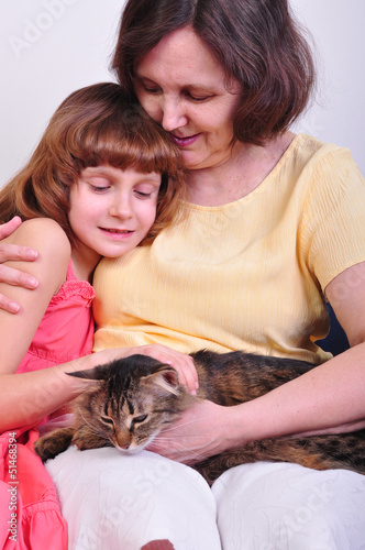 grandmother and granddaughter with their cat