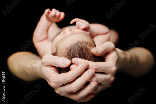 Male hands with baby
