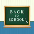 back to school written on blackboard