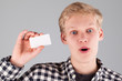 Young handsome guy holding a blank card