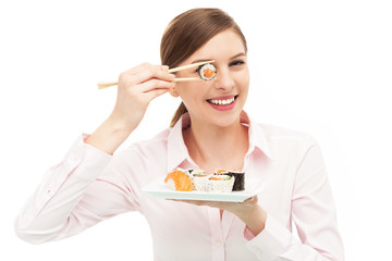 Beautiful woman eating sushi