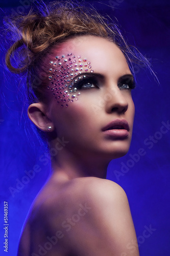 Beautiful woman with fantasy makeup