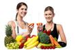 Smiling girls holding juicy slice of an orange