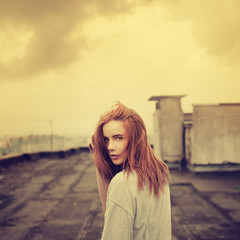 beautiful girl on the roof. vintage photos in yellow
