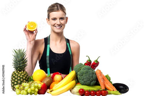 The beautiful girl with fruits and vegetables
