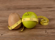 Diet concept, kiwi fruit with green apple and measuring tape on
