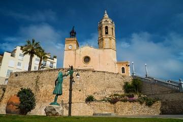 Statue of a woman against church of Sant Bartomeu