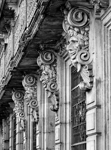 Historic building facade with masks © Nejron Photo