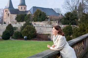 Young woman enjoying spring sunshine in a German city