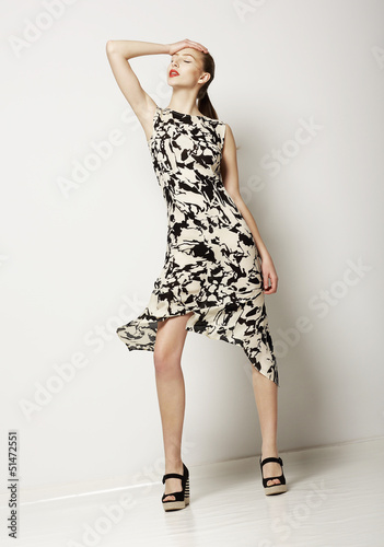 Fashion Woman in Light Spotty Dress. Contemporary Apparel