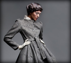 Nostalgia. Romantic Lady in Classic Coat. Pinup Style
