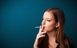 Beautiful woman smoking cigarette vith copy space