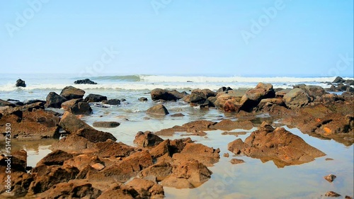 Sea stones with ocean waves on Arambol beach India