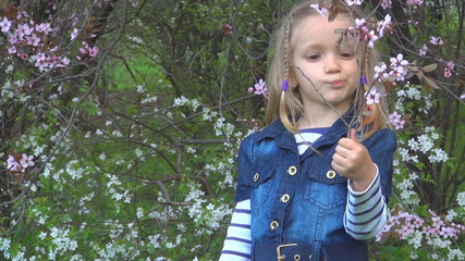 Child Smelling Spring Flowers, Playing in Park, Children