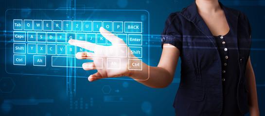 Girl pressing virtual type of keyboard