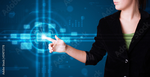 Woman pressing high tech type of modern buttons