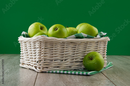 Green apples on emerald