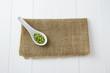 Green lentils in spoon
