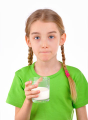 Girl tasting a glass of milk
