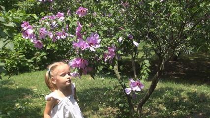 Child Sneezing after Smelling Spring Flowers in Park, Children