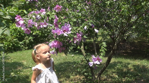 Child Sneezing after Smelling Spring Flowers in Park, Children