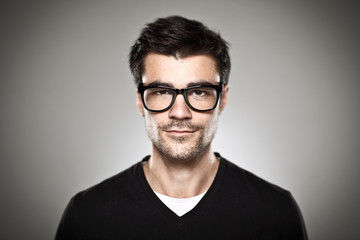 Portrait of a normal boy with rimmed glasses