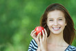 portrait of attractive girl eating apple