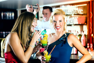 Young women with cocktails in club or Bar