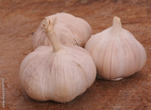 Fresh garlic on a wooden background