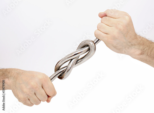 Sturdy knot of iron rod in male hands