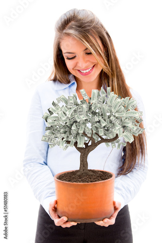 Business woman with a money tree
