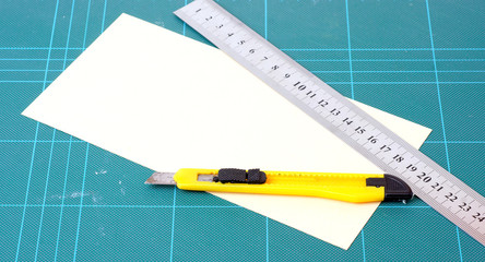 knife, paper,  ruler