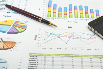 Financial paper charts and graphs with iphone and calculator
