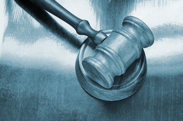 Judge's gavel on wooden background