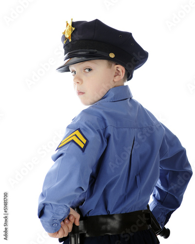 Little Cop Looking Over Shoulder