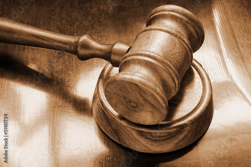 Judge's gavel on wooden background