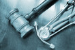 Gavel and stethoscope on wooden background