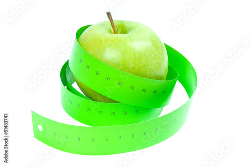 Dieting concept. Green apple and tape measurement